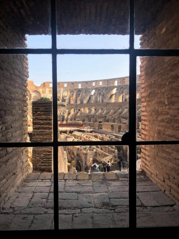 Inside the Colosseum through a barred window